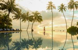 Girl Alone Dancing on the Pool`s edge. At Maldives island royalty free stock images