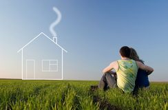 Guy And Girl In The Field And Dreams About Home Stock Photos