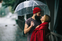 Guy And Girl Under An Umbrella Stock Images