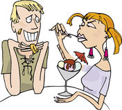 Guy and angry girl eating ice-cream. In coffee bar Stock Photography