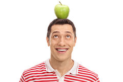Guy with an apple on his head. Young guy with an apple on his head  on white background Royalty Free Stock Photography