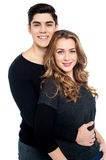Guy with arms around her girlfriend's waist Royalty Free Stock Photos