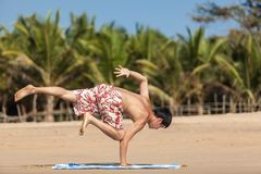 Occupations by yoga on a beach Royalty Free Stock Photos