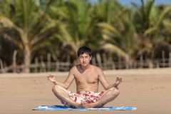 Occupations by yoga on a beach Stock Image