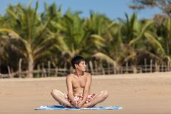 Occupations by yoga on a beach Stock Photography