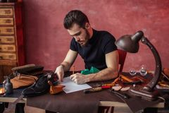 Guy attending shoe making classes. Education, a part time job stock photos