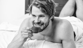Guy attractive appearance man enjoy hot fresh brewed coffee close up. First sip. Every morning with his coffee. Best stock image