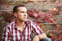 Guy in autumn park Stock Image