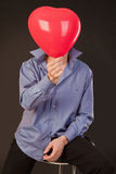 Guy with balloon Stock Photo