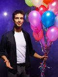 Guy with balloons Royalty Free Stock Photo