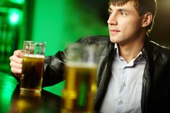 Guy at bar counter Royalty Free Stock Photo