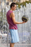 Guy with a basketball. Royalty Free Stock Photos