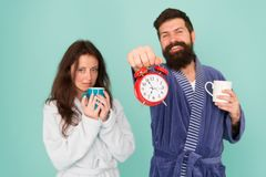 Guy in bath clothes hold tea coffee. Breakfast concept. Every morning begins with coffee. Couple in bathrobes with mugs. Its coffee time. Man with beard and stock photography