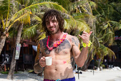 The guy on the beach of Haad Rin after the Full Moon party. Thailand. Royalty Free Stock Photography
