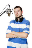 Guy with a beard in the headphones and microphone. Young guy with a beard in the headphones and microphone, isolated on white background Stock Image
