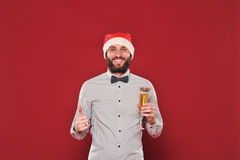 Guy with a beard wishes Merry Christmas Stock Images
