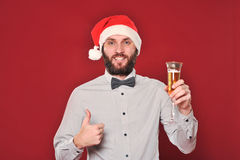 Guy with a beard wishes Merry Christmas Royalty Free Stock Photography