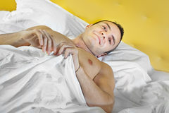Guy in bed Royalty Free Stock Images