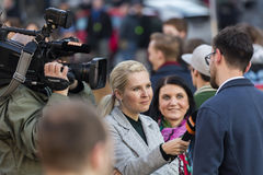 A guy being interviewed at the demonstration on Prague Wenceslas square against the current government and Babis Stock Photo