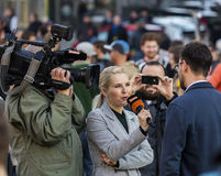 A guy being interviewed at the demonstration on Prague Wenceslas square against the current government and Babis Royalty Free Stock Photos