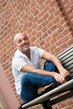 Guy on a Bench Stock Image