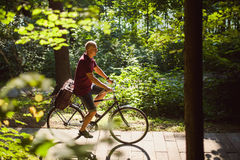 A guy with a bicycle Stock Image