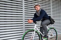 Guy on bicycle Stock Photography