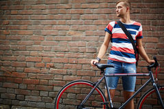 Guy with bicycle Stock Images