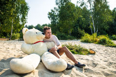 Guy with a big teddy bear Royalty Free Stock Photo