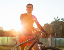 The guy with the bike in the early morning Stock Photo