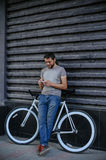 The guy with the bike and fix the phone royalty free stock photography