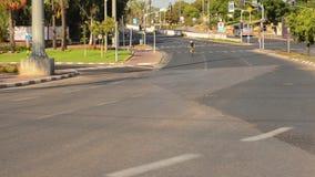 Guy biking on deserted city road fastly stock video