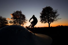 Guy Biking at Sunset Royalty Free Stock Photo