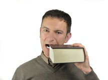 Guy biting a big book Royalty Free Stock Images