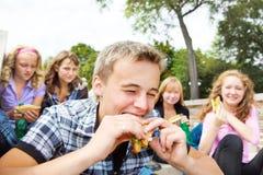 Guy biting sanwich Royalty Free Stock Photo