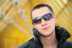 Guy in black jacket. On footbridge Stock Photography