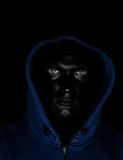 Guy with black painted face. In blue jacket Royalty Free Stock Photography