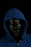 Guy with black painted face Stock Photo