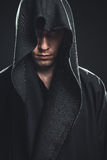 Guy in a black robe. Serious guy in a black robe Royalty Free Stock Photos