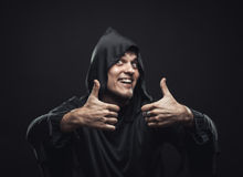 Guy in a black robe showing thumbs up Stock Images