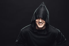 Guy in a black robe Stock Photos