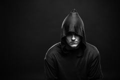 Guy in a black robe Stock Photography