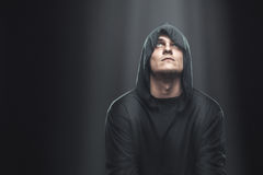 A guy in a black robe standing in the dark Royalty Free Stock Photography