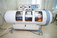 The guy in the black T-shirt lies in the hyperbaric chamber royalty free stock photos