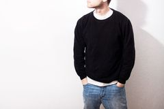 The guy in the Blank black hoodie, sweatshirt, stand, smiling on royalty free stock photos
