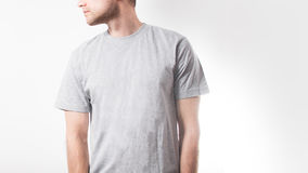 The guy in the blank grey t-shirt, stand, smiling on a white background, mock up, free space, logo, design, template for design p. Rint stock photos