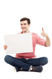 Guy with blank sign showing thumbs up Royalty Free Stock Image