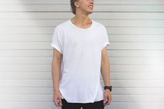 Guy in a blank white t-shirt. On white background Stock Photography