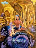 A guy in a blue crystal crown and a mermaid guy sitting by a lake in a grotto with crystals and stalactites royalty free stock photography