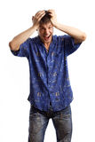 Guy in the blue shirt series. Screaming guy in the blue shirt scream and hold his head in his hands over white background Stock Image